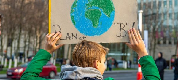 Kid holding a sign about the planet